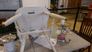 Chair on table with seat being repaired